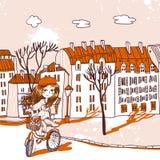 Muchacha bonita con la bicicleta Imagen de archivo