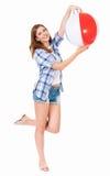 Muchacha bonita con la bola de playa Foto de archivo libre de regalías