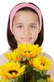 Muchacha bonita con las flores Foto de archivo libre de regalías