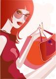 Muchacha bonita con los bolsos de compras Imagen de archivo
