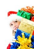 Muchacha bonita con los regalos de Navidad foto de archivo libre de regalías