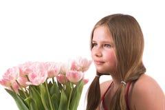 Muchacha bonita con los tulipanes Imágenes de archivo libres de regalías