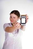 Muchacha bonita con un smartphone Foto de archivo libre de regalías