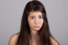 Muchacha bonita con una cara triste Imágenes de archivo libres de regalías