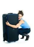 Muchacha bonita con una maleta fotos de archivo libres de regalías