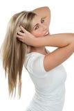 Muchacha bonita coqueta que juega con su pelo Imagen de archivo libre de regalías