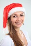 Muchacha bonita de la Navidad en el sombrero de santa Imagen de archivo libre de regalías