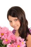 Muchacha bonita de ocho años con las flores Foto de archivo libre de regalías