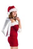Muchacha bonita de santa que sostiene bolsos del regalo Imágenes de archivo libres de regalías