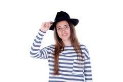 Muchacha bonita del adolescente con el sombrero negro que presenta en el estudio Fotos de archivo