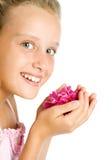 Muchacha bonita del adolescente con la flor en manos Foto de archivo