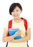 Muchacha bonita del estudiante que se coloca sobre el fondo blanco Fotografía de archivo