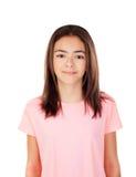 Muchacha bonita del preteenager con la camiseta rosada Foto de archivo libre de regalías