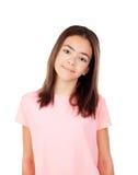 Muchacha bonita del preteenager con la camiseta rosada Imágenes de archivo libres de regalías
