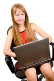Muchacha bonita del teenage? con la computadora portátil aislada en blanco Imágenes de archivo libres de regalías