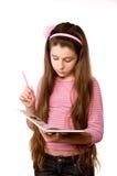 Muchacha bonita en la edad del libro de lectura once Fotos de archivo