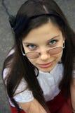 Muchacha bonita en lentes Imágenes de archivo libres de regalías