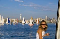 Muchacha bonita en un barco de vela Fotografía de archivo libre de regalías