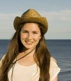 Muchacha bonita en un sombrero de vaquero Imágenes de archivo libres de regalías
