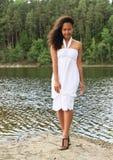 Muchacha bonita que camina por el agua imagen de archivo libre de regalías
