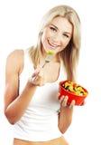 Muchacha bonita que come las frutas Foto de archivo libre de regalías