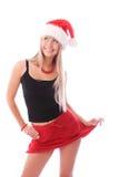 Muchacha bonita que desgasta el sombrero de Santa Imagen de archivo