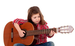 Muchacha bonita que toca la guitarra Foto de archivo