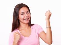 muchacha bonita 20s que celebra su victoria Imágenes de archivo libres de regalías