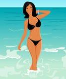 Muchacha bronceada bonita en la playa Foto de archivo libre de regalías
