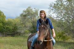 Muchacha a caballo Foto de archivo libre de regalías
