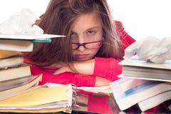 Muchacha cansada de trabajo de la escuela Foto de archivo libre de regalías