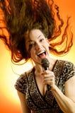Muchacha cantante imagen de archivo libre de regalías
