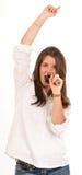 Muchacha cantante con un cepillo para el pelo Imagen de archivo