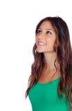Muchacha casual atractiva en el verde que mira para arriba Fotos de archivo