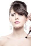 Muchacha caucásica durante maquillaje Fotografía de archivo libre de regalías
