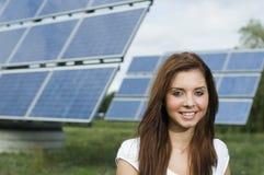 Muchacha cerca de los paneles solares Imágenes de archivo libres de regalías