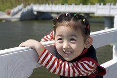 Muchacha china con sonrisa Imagen de archivo libre de regalías