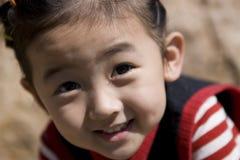Muchacha china con sonrisa Fotos de archivo libres de regalías