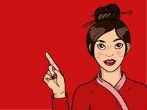 Muchacha china en arte pop Mujer asiática atractiva joven con la boca abierta Palillos en la cabeza Fotografía de archivo libre de regalías