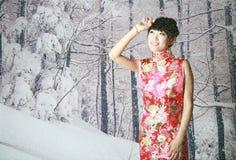 Muchacha china en las escenas de la nieve Imágenes de archivo libres de regalías