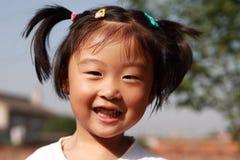 Muchacha china feliz Foto de archivo