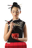 Muchacha china y alimento oriental Foto de archivo libre de regalías