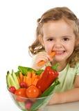 Muchacha chomping de la zanahoria feliz Imagenes de archivo