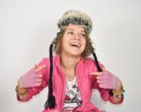 Muchacha cobarde con un sombrero divertido Fotografía de archivo libre de regalías