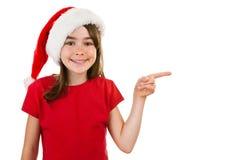Muchacha como señalar de Papá Noel Imagenes de archivo
