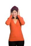 Muchacha con ambas palmas que cubren los oídos Fotos de archivo libres de regalías