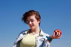 Muchacha con Apple Foto de archivo libre de regalías