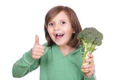 Muchacha con bróculi Imagen de archivo