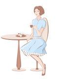 Muchacha con café en el café Fotos de archivo libres de regalías