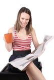 Muchacha con café y el periódico Foto de archivo